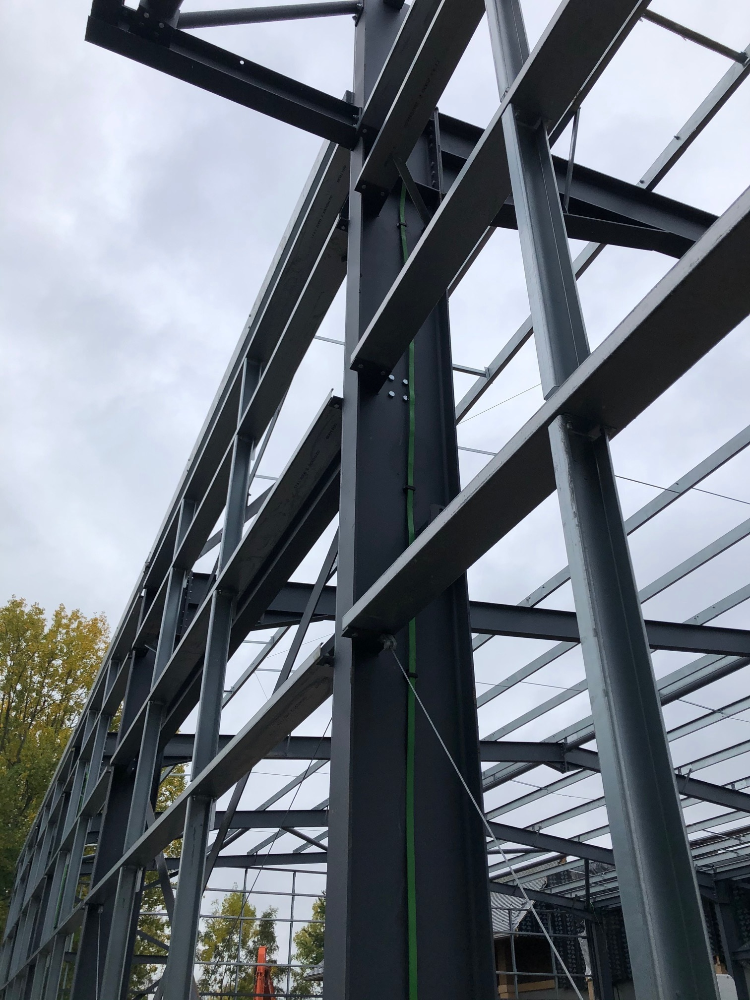 Wallis Lightning Protection Tape Installed and clipped to the vertical steels. A ring circuit at roof level then links the cage structure and the system terminate into the ground via earth rods accessed through concrete earth pits.